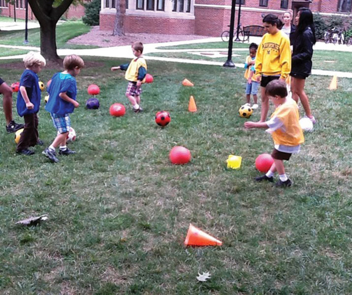 Children in the experimental group run through part of the motor skills intervention. (Photo courtesy of Leah Ketcheson, PhD.)