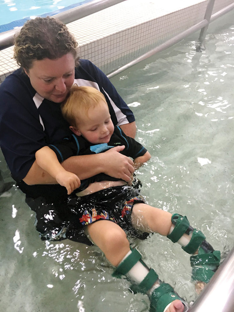 This child gets water- based TR to strengthen his lower extremities for greater mobility on land. (Photo courtesy of Robyn Winston Cohen, CTRS.)